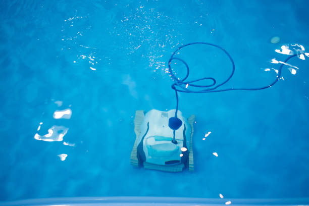 The robot is cleaning the pool. Maintenance pool concept.